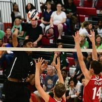 Wauwatosa West's Alou Dillon goes up for a kill attempt over Wauwatosa East's Ben Miller (14) on Sept. 22. The Trojans came away with a four-set victory.