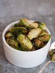 This photo shows fried Brussels sprouts.