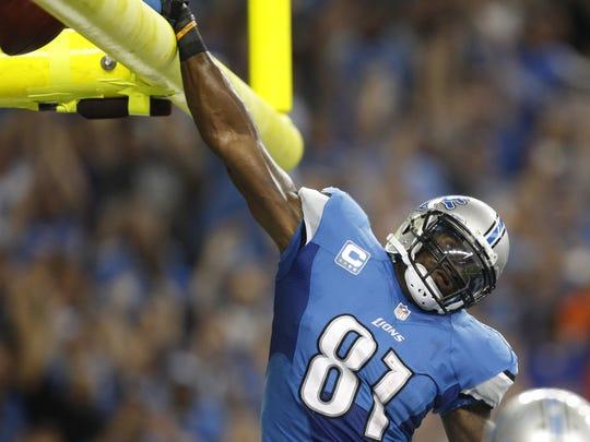Detroit Lions wide receiver Calvin Johnson celebrates Sept. 8, 2013.