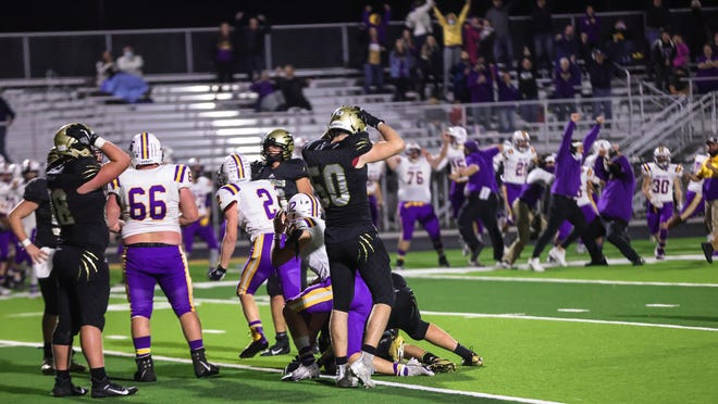Andover Central players react to a fourth down stop by Arkansas City on Friday, Nov. 6 at Jaguar Stadium in Andover, Kansas. The Bulldogs beat the second-seeded Jaguars 33-28 to advance to the Class 4A quarterfinals against Wamego next week.
