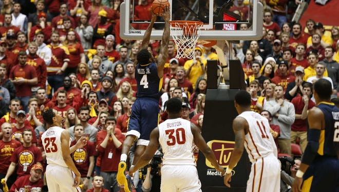 West Virginia sophomore Daxter Miles Jr. dunks the ball against Iowa State on Tuesday, Feb. 2, 2016, at Hilton Coliseum in Ames, Iowa.