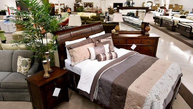 Furniture, including living room sets, bedroom sets and mattresses, is shown Wednesday at Bon-Ton's furniture gallery in the Queensgate Shopping Center in York Township. Bon-Ton at the York Galleria is one of 24 stores that will feature a furniture department as part of the company's expansion.