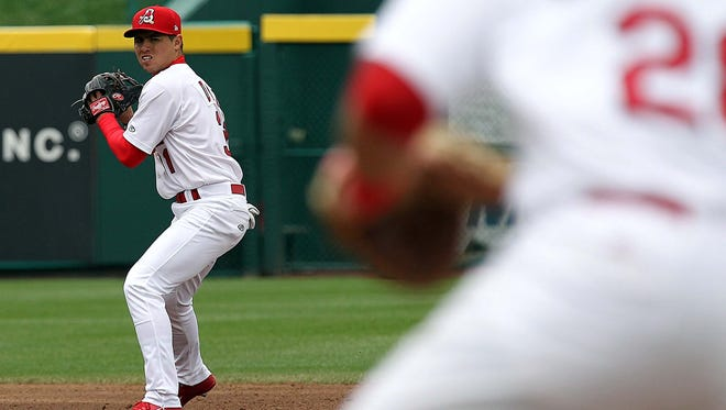 The Springfield Cardinals' Aledmys Diaz looks to make the throw to first base against the Corpus Christi Hooks at Hammons Field on April 8, 2014.