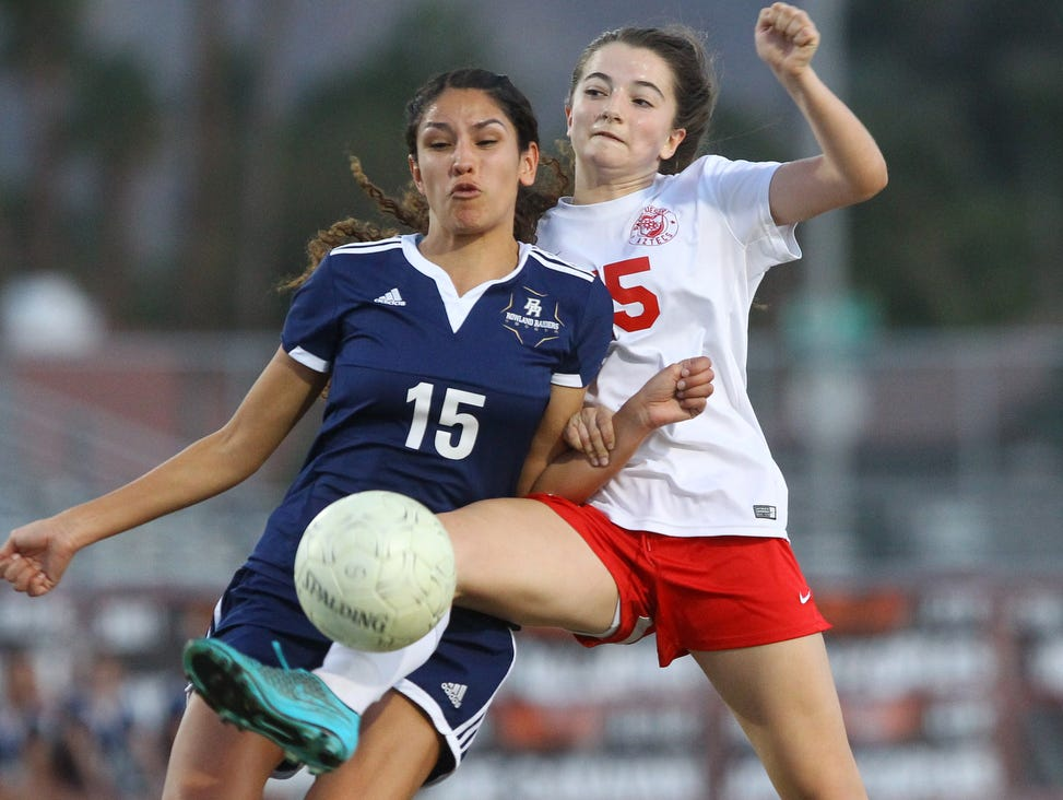 at far right, Palm Desert High School's Malia Falk tries to control the ball against Rowlands Heights at Palm Desert on February 16, 2017.