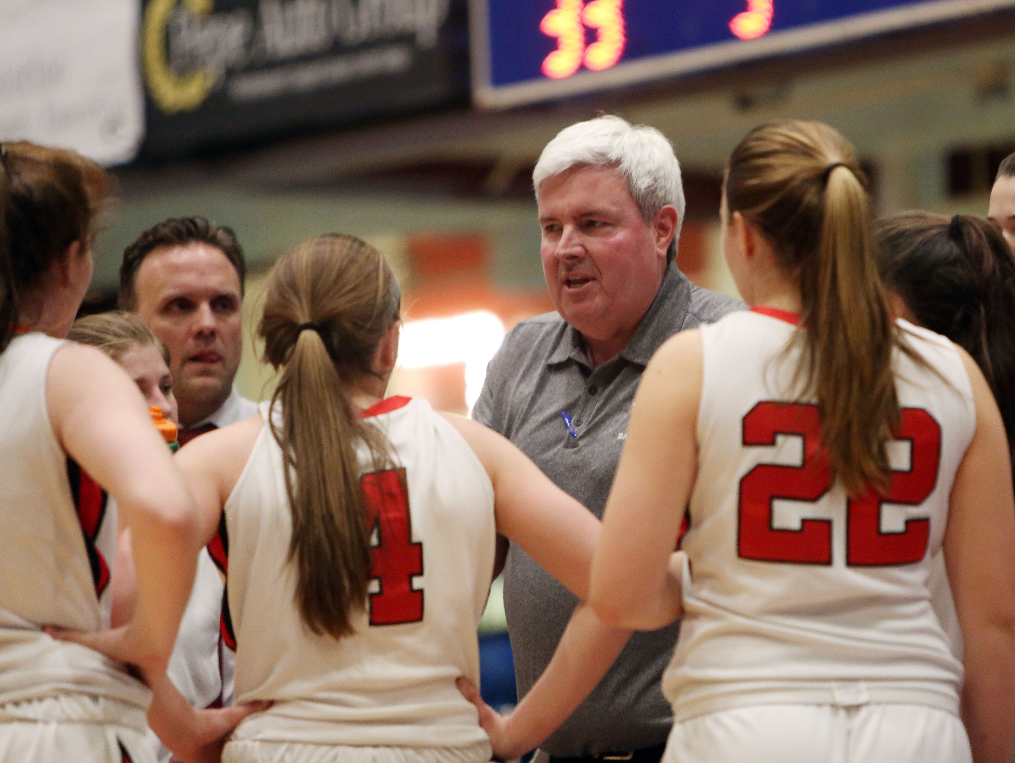 Rye girls basketball head coach Dennis Hurlie talks to his team during a timeout against Saugerties in the Class A state regional semifinal at the Westchester County Center in White Plains March 1, 2016.