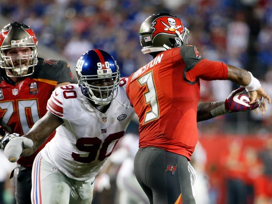 New York Giants defensive end Jason Pierre-Paul (90) hits Tampa Bay Buccaneers quarterback Jameis Winston (3) after a pass attempt during the fourth quarter of an NFL football game Sunday, Nov. 8, 2015, in Tampa, Fla.