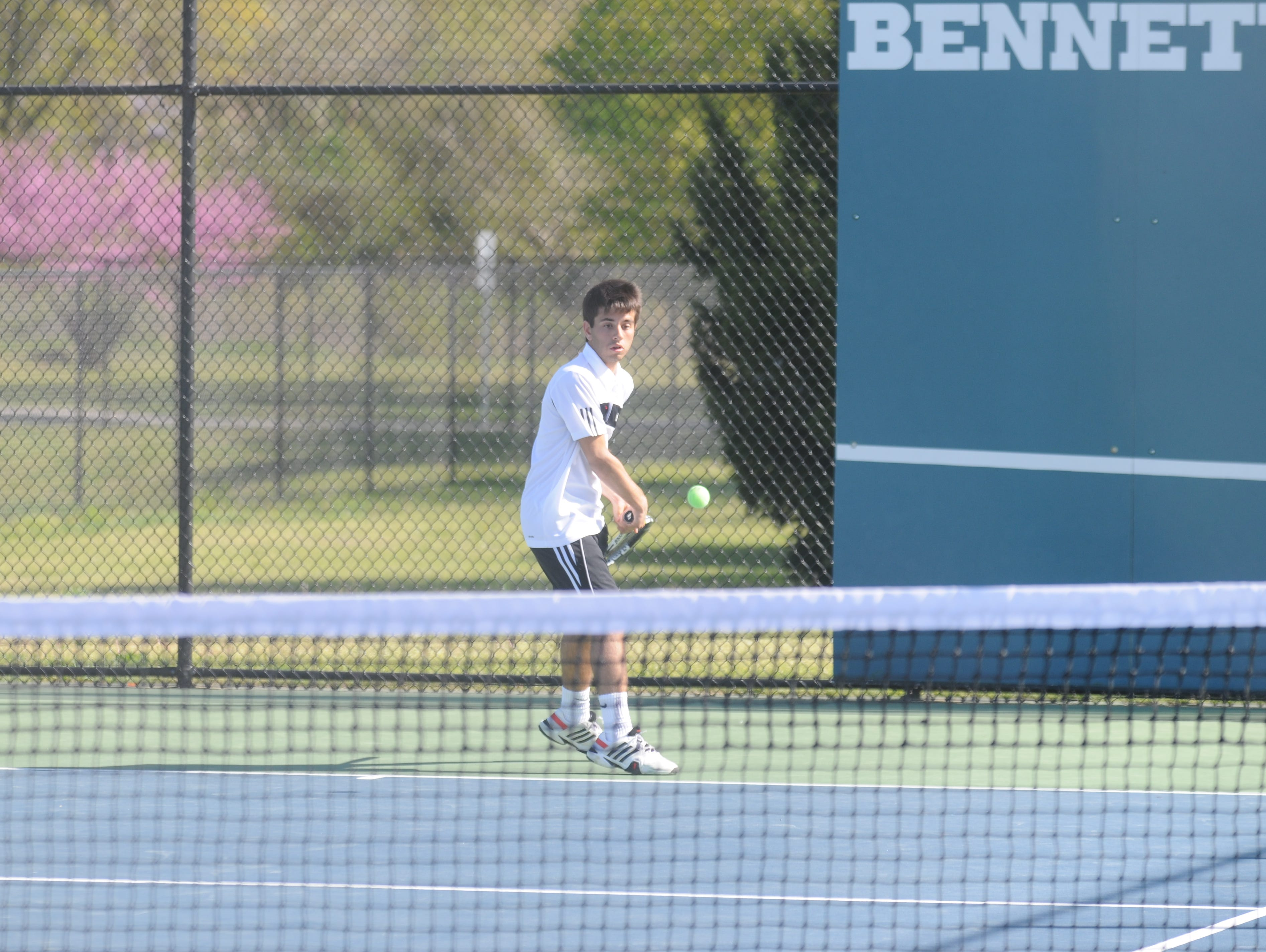 Calm, cool and collected, Kieran Murphy returns a serve during a singles match against Worcester Prep on Wednesday in Salisbury.