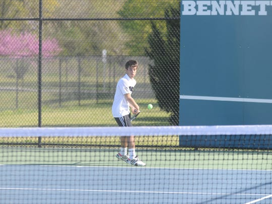 Calm, cool and collected, Kieran Murphy returns a serve