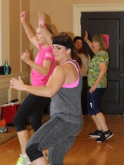Hands in the air during the COTS Zumbathon event.