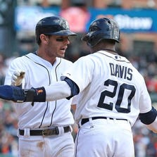 Rajai Davis is first to greet Ian Kinsler at home plate after his seventh-inning, two-run home run off Brian Shaw put the Tigers in the lead for good Sunday. On Saturday, Shaw allowed an eighth-inning homer to Alex Avila.