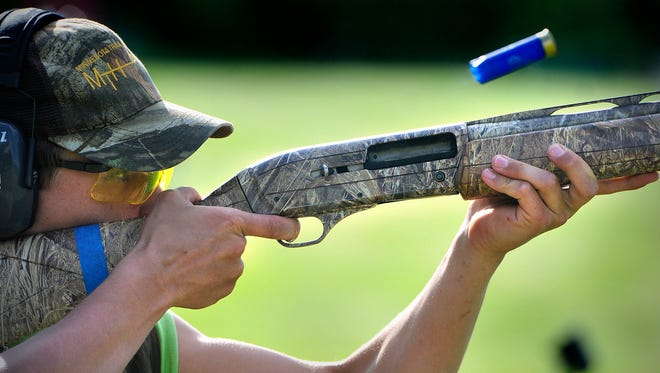 Foley trap team member Jordan Beack shoots at a clay target while practicing at Del Tone/Luth Gun Range in St. Cloud on Friday.