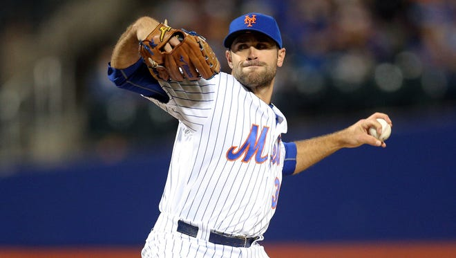 New York Mets starting pitcher Sean Gilmartin  pitches against the Philadelphia Phillies during the first inning Saturday nighth at New York's Citi Field.