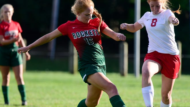 Oak Harbor's Noelle Petersen looks to get a touch on the ball before a Huron opponent.