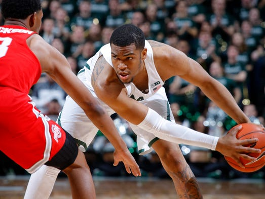 Michigan State's Alvin Ellis III, right, looks to get