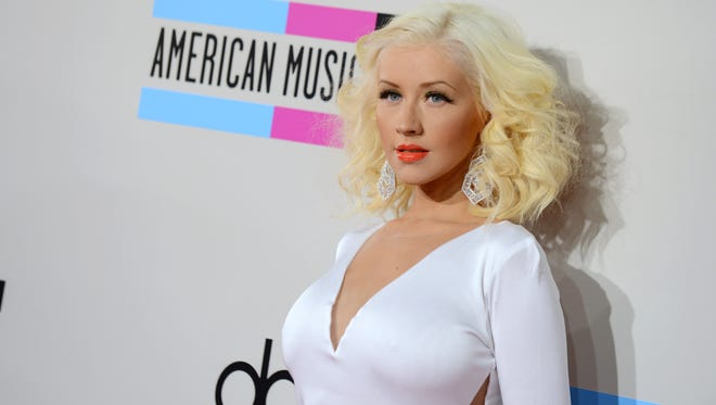 In this Nov. 24, 2013, file photo, Christina Aguilera arrives at the American Music Awards at the Nokia Theatre L.A. Live, in Los Angeles. The NBA announced Tuesday, Jan. 27, 2015, that Aguilera will perform ahead of the 64th annual NBA All-Star Game on Feb. 15 at Madison Square Garden in New York City.