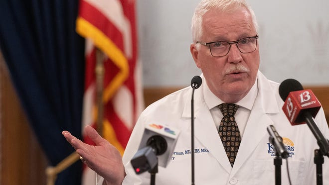 Kansas Department of Health and Environment Secretary Lee Norman appears at a news conference on COVID-19 in August. His agency is falling in line with new federal guidelines on how long residents should quarantine for potential exposure to the novel coronavirus.