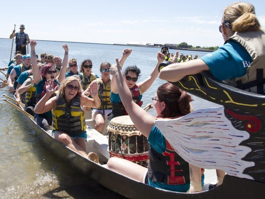 Dragon boat racing team Blood Center of Wisconsin cheers