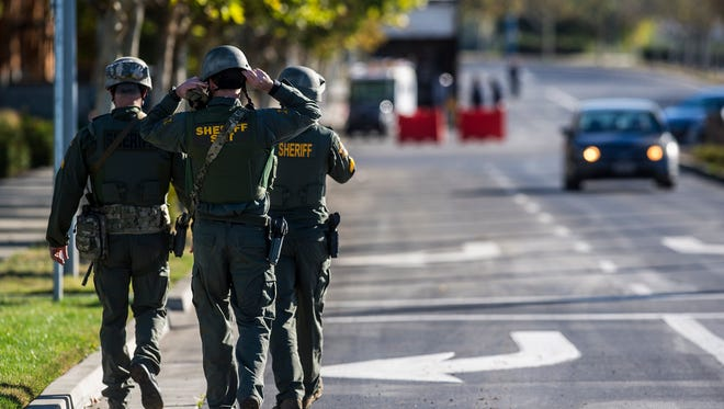 Merced County Sheriff SWAT members enter the University of California, Merced campus after a reported stabbing in Merced, Calif., Wednesday, Nov. 4, 2015. An assailant stabbed five people on the rural university campus in central California before police shot and killed him, authorities said Wednesday.