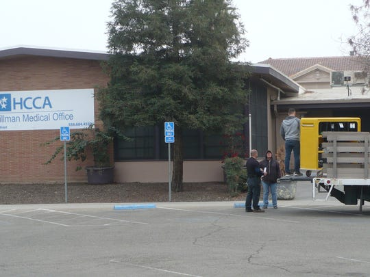 Tulare hospital employees move equipment from the Hillman Clinic on Wednesday.
