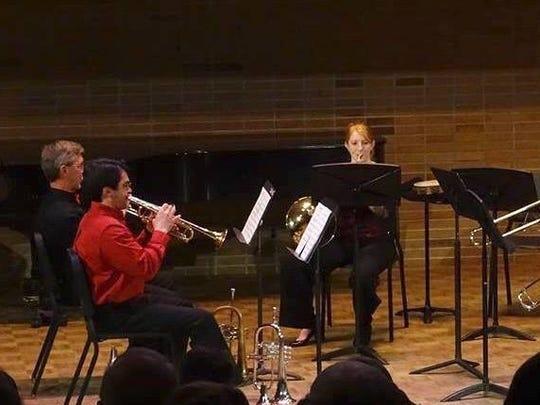 UE faculty brass