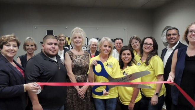 San Angelo Mayor Brenda Gunter and Councilmember Harry Thomas were on hand with the Chamber of Commerce's Concho Cadre to celebrate the grand opening of JW Real Estate, located at 610 S. Abe St., Ste B., with Jerrie Woodford (holding scissors), Gina Birdsong, Paul Yanez, Samantha Tarr, and Landry Scott on Sept. 21, 2017.