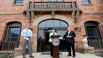 Daniel Warvi, Cynthia McCormack and Paul Roberts hold a news conference May 5 outside the Department of Veterans Affairs office in Cheyenne, Wyoming, in response to scheduling issues at the Fort Collins VA clinic.