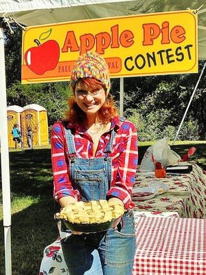 Kelly Shipe-Jeffers holds an entry for the apple pie competition held during the 2015 Washington Presbyterian Church Apple Festival.