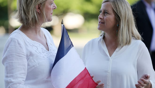 Amelie de Gaulle, left, Honory Consul of France in Nashville, speaks with Mayor Megan Barry during a vigil held in Public Square for the city of Nice in response to last week's terrorist attack Sunday July 17, 2016.
