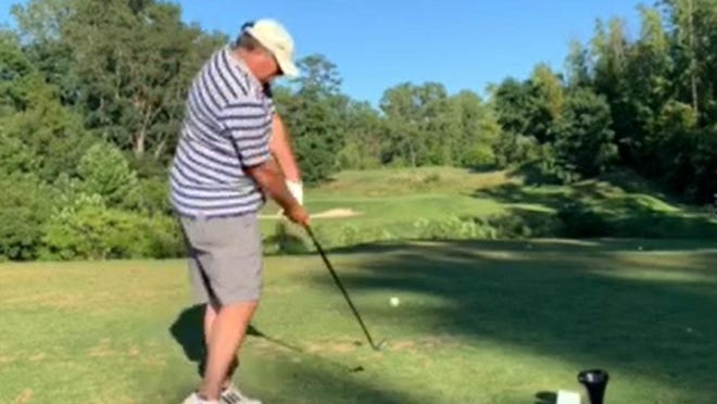 In this screen grab from Justin Howell's video, Vincent Savelli makes contact with the ball on the No. 4 tee at Erie Golf Club. Savelli made a hole-in-one on the shot, and Howell's video has gone viral.
