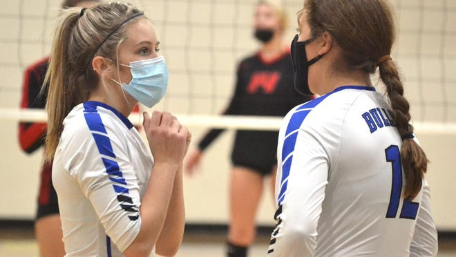 Inland Lakes junior Olivia Monthei (left) and sophomore Natalie Wandrie (12) have a chat during a set against Onaway in a Division 4 regional semifinal matchup at Wolverine on Tuesday. The Inland Lakes volleyball team, like football and cross country, has had great success over the last two weeks, recently winning a district title and also earning a spot in Thursday's regional final against Rudyard.