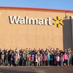 Members of law enforcement departments from across Washington County gather to have breakfast and Christmas shop with area children Saturday, Dec. 12, 2015.