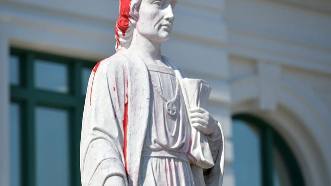 The Christopher Columbus statue at Union Station after vandals defaced the statue and base with red paint June 22.