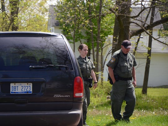 Eden Ross, left, and Mike Ehart, the city of Battle Creek's animal control officers, respond to a welfare check request at an Upton Avenue home. No one was at the residence, and a dog was not located.