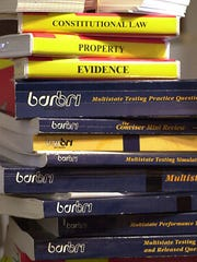 This photo illustration shows study material for a bar exam.