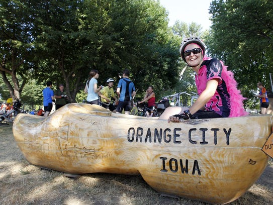 Jodi Plopan of Canton, Mich., sits in a giant wooden