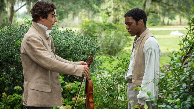 """Benedict Cumberbatch as ?William Ford? and Chiwetel Ejiofor as ?Solomon Northup? in a scene from the motion picture """"12 Years a Slave."""""""