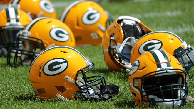 Green Bay Packers helmets are shown during organized team activities Monday, June 4, 2018 in Green Bay, Wis.