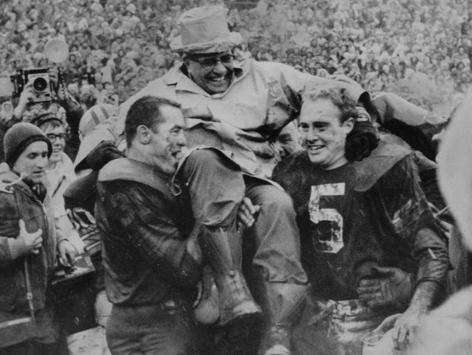One of the high spots in the spectacular career of coach Vince Lombardi came when his Green Bay Packers defeated Cleveland for the NFL championship in 1966 and was carried off the field by Louisville's Paul Hornung (right) and Jim Taylor.