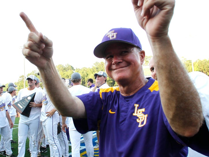 LSU head coach Paul Mainieri signals to the fans after they defeated Florida 2-0 at the Southeastern Conference NCAA college baseball tournament on Sunday, May 25, 2014, in Hoover, Ala. (AP Photo/Butch Dill)