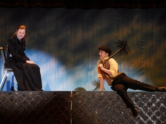 """Noah Tart, right, plays Bert and Cierra Wecker plays Mary Poppins during rehearsal for """"Mary Poppins"""" at Kennard-Dale High School Thursday, February 18, 2016. The show runs February 25-28."""