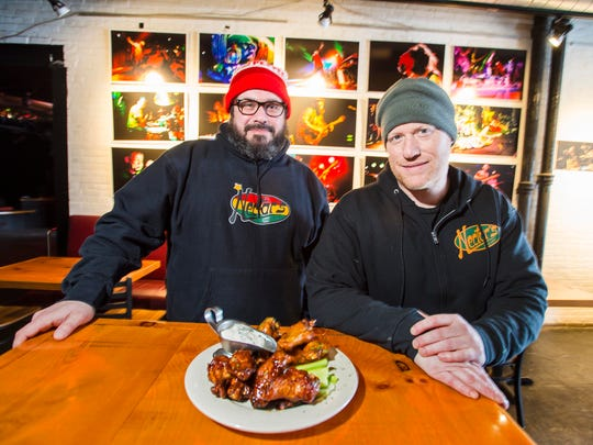 Brian Mital, left, and Jason Gelrud with two offerings of chicken wings at Nectar's in Burlington on Monday, January 29, 2018.