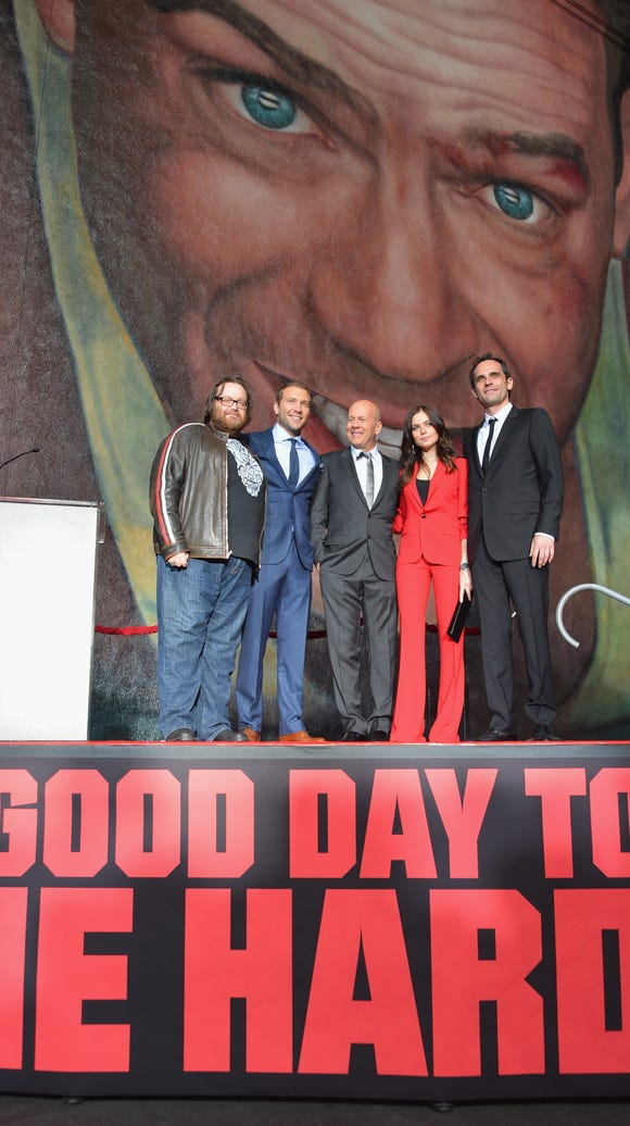 """A Good Day to Die Hard"" director John Moore, actors Jai Courtney, Bruce Willis, Yulia Snigir and Rasha Bukvic attend the dedication and unveiling of a new soundstage mural celebrating 25 years of ""Die Hard"" at Fox Studio Lot on Jan. 31, 2013, in Century City, Calif."