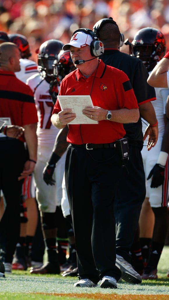 CLEMSON, SC - OCTOBER 11:  Head coach Bobby Petrino of the Louisville Cardinals looks on during the game against the Clemson Tigers at Memorial Stadium on October 11, 2014 in Clemson, South Carolina. (Photo by Tyler Smith/Getty Images)