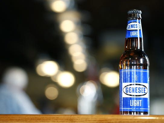 A Genny Light beer bottle on the bar at the Genesee