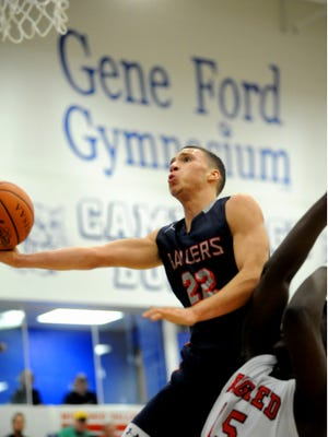 Morgan's Marcus Mayle goes up for a shot during the Raiders' district final loss to Steubenville during the 2015-2016 season. Mayle and his brother, Raider standout Dre Norman, signed with Ohio Valley on Friday.