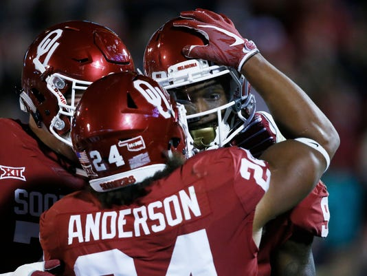 Oklahoma wide receiver CeeDee Lamb, right, celebrates a touchdown with teammate Rodney Anderson (24) in the first quarter of an NCAA college football game against Texas Tech in Norman, Okla., Saturday, Oct. 28, 2017. (AP Photo/Sue Ogrocki)