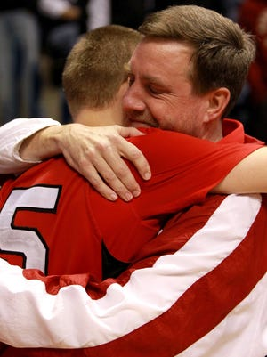 From March 2011, La Salle's Ryan Fleming (25) gives his dad and coach Dan Fleming a big hug after La Salle beat Moeller in the Division I regional boys basketball semifinal game at Cintas Center at Xavier University.
