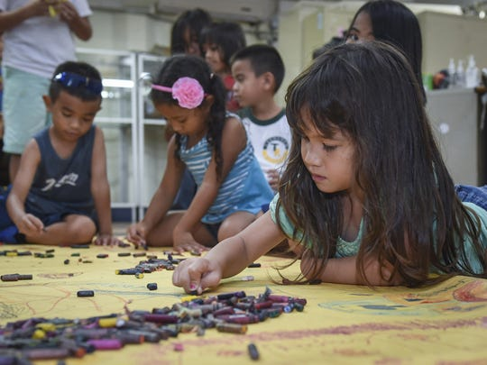 Isaballa Orsini, 6, of Talofofo, draws a mural with her friends at the Agana Heights summer camp on June 16. Isabella chose to draw a picture of her house to show her parents at the end of the day. Mark Scott/PDN/mscott5@guampdn.com
