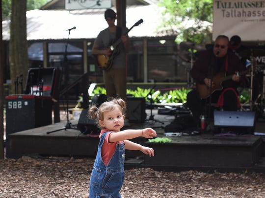 Clara Portillo, 3, dances during the Jazz & Blues Festival at the Tallahassee Museum.