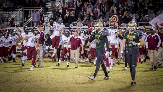 Red Mountain celebrates after defeating Skyline 16-13 in the 6A first-round football playoff game at Skyline High School on Friday, Nov. 4, 2016 in Mesa.